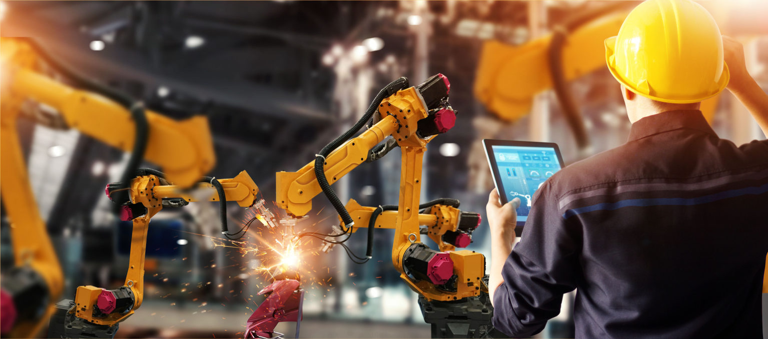 worker controlling robot, robotics provider MA, robotics Massachusetts, automation services Massachusetts, automation services MA