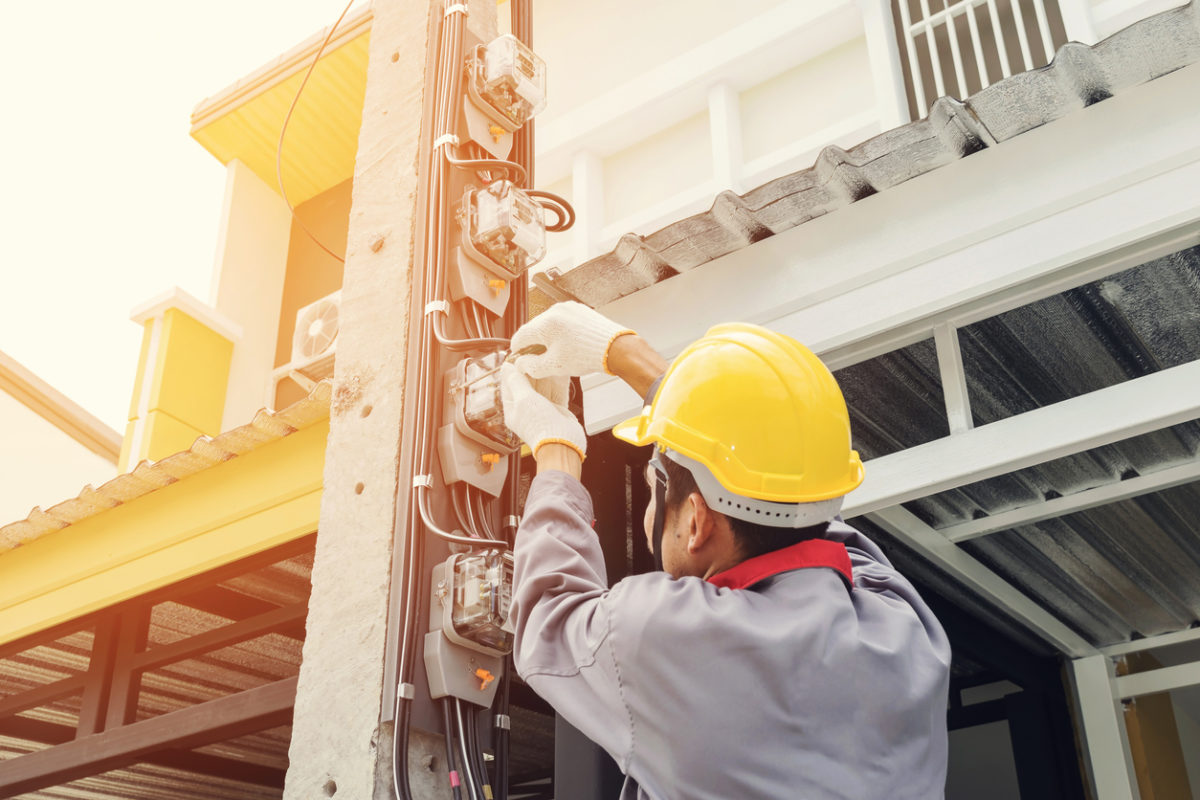 worker fixing electrical wires, industrial electrical services MA, electrical services Massachusetts